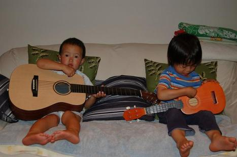 Kids playing guitar. Licensed through creative commons.